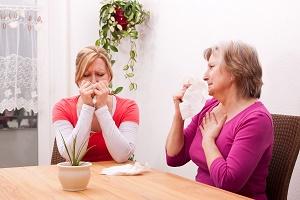family caregiver talking to senior parent about caregiver grief