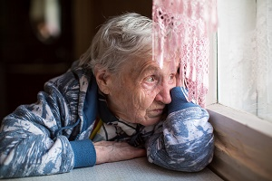senior woman experiencing weather-related depression