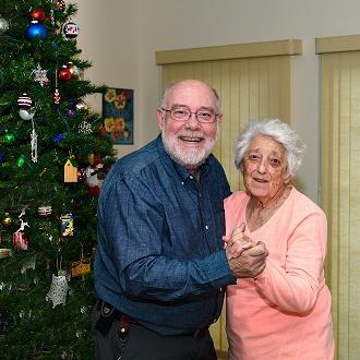 respite care fargo nd, two seniors with Christmas Tree