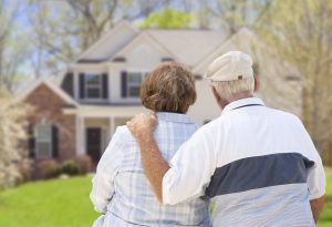 Senior couple looking at their home