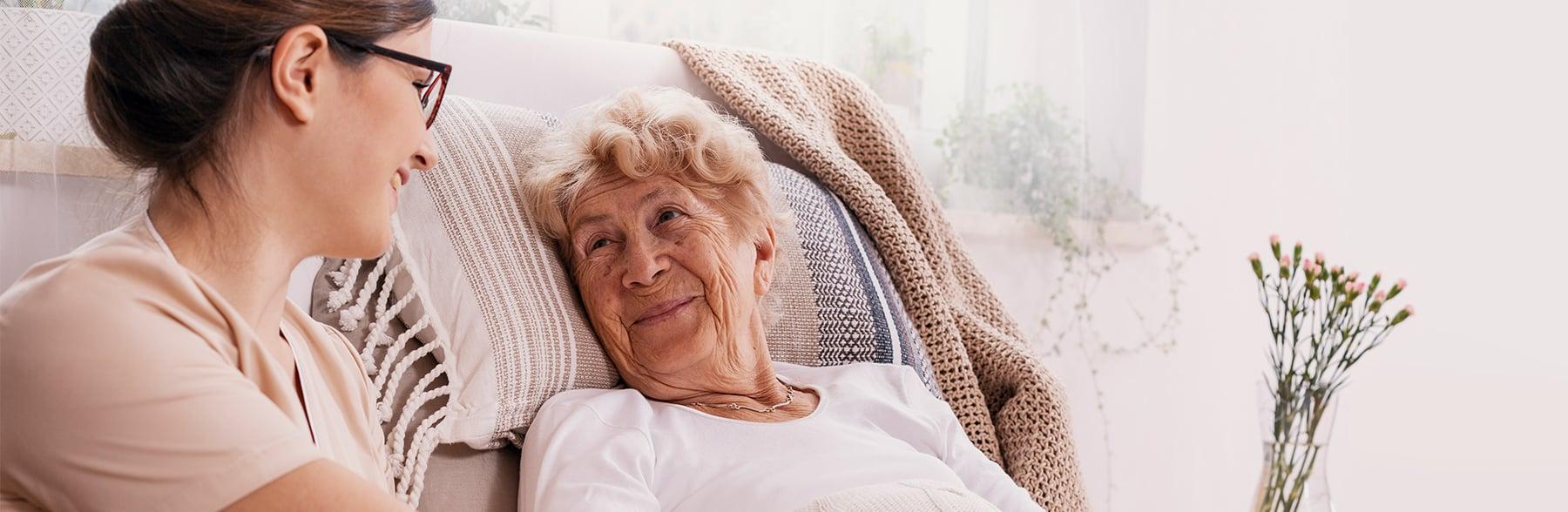 Caregiver by senior client's bedside