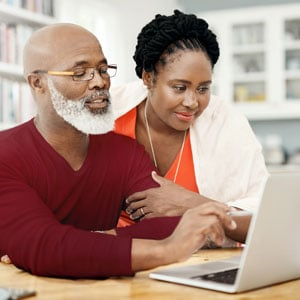 Couple looking up information on laptop